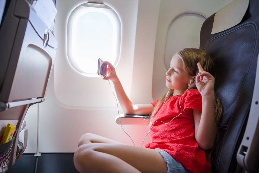 Newswise: GettyImages%20Girl%20on%20Airplane.jpg