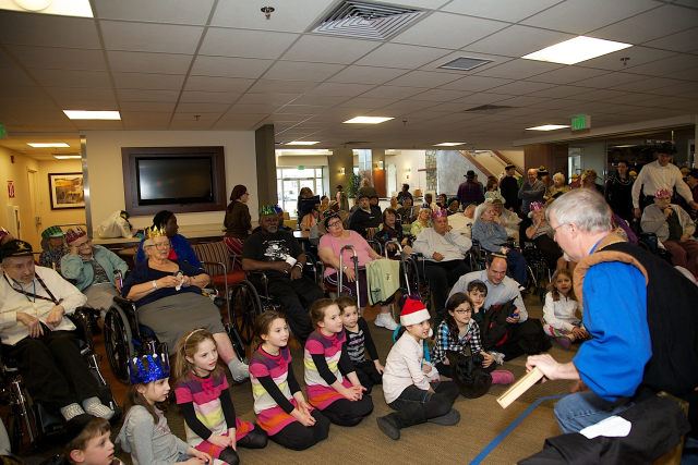 Residents, families and Auxiliary enjoying music             and magic at our Face-to-Face event