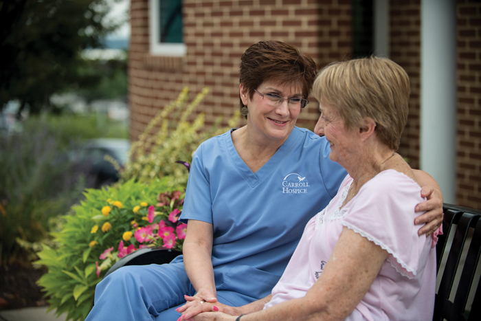 Carroll Hospice employee comforting a patient