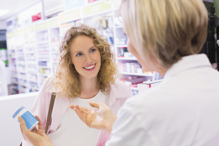 Pharmacist discussing a prescription with a customer