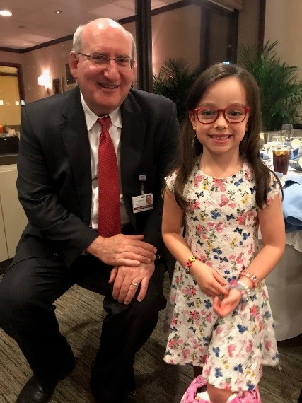 Dr. John Herzenberg smiling with his patient Niamh