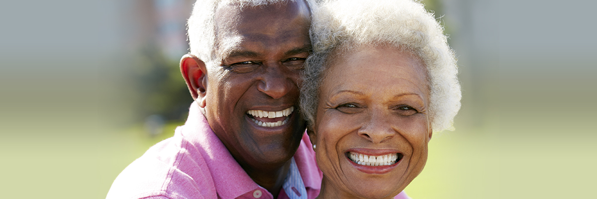 Smiling mature couple outside