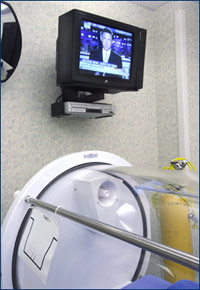 During the sessions, patients can watch TV or videos on a monitor which is just outside the chamber.