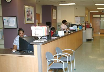 Friendly and professional staff members greet patients when they arrive to register for their daily treatments