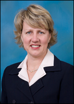 Julie Cox,  Vice President, Development