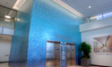 Main lobby entrance elevators and lobby area with mosaic tile features