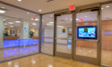 Entrance into the inpatient unit from the elevators. Flat screen TV broadcasts a live feed from the National Aquarium in Baltimore