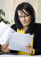 Woman reading paperwork