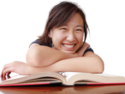 Smiling teen reading