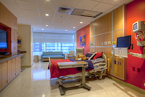 A hospital room with a patient bed inside the Herman & Walter Samuelson Children's Hospital