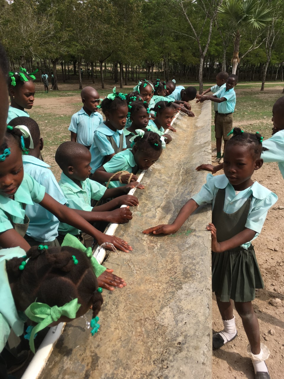 children using water system