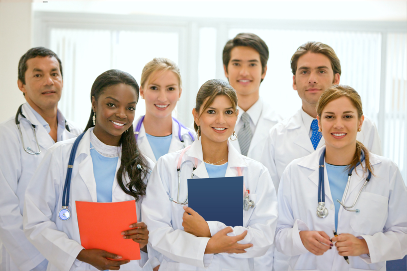 Doctors standing with residents and fellows