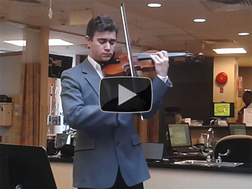 Peabody Conservatory graduate student performs a concert for patients in the Cancer Institute's outpatient infusion center.
