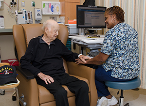Nurse with a patient in the Northwest Hospital Outpatient Infusion Center