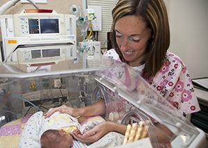 Nurse with a baby in the Sinai NICU